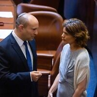 Naftali Bennett, left, and Tamar Zandberg in the Israeli parliament, June 2, 2021. Both have been targeted by death threats due to their opposition to Prime Minister Benjamin Netanyahu, who is trying to remain in power. (Olivier Fitoussi/Flash90)