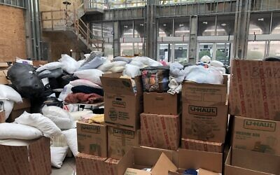 A social hall under construction in The Shul, a synagogue in Surfside, Fla., is piled high with donations for homeless families less than 18 hours after a nearby building collapsed, June 25, 2021. (Ron Kampeas/JTA)