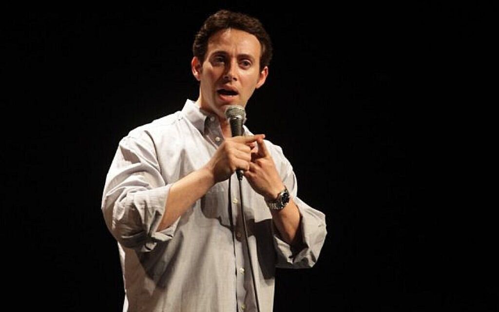 Avi Liberman performs at Comedy for Koby. (Photo by Yissachar Ruas via The Times of Israel)