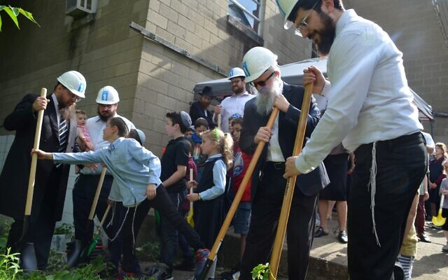 Members of the Greenfield Jewish community recently participated in the ground breaking of new mikvahs at Bnai Emunah Chabad . Photo by Yehuda Welton.