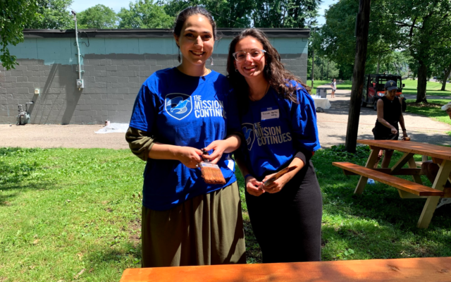 Hadassah Cowen and Sarah Hertzberg staining a table at the Juneteenth event (Photo by James Musial)