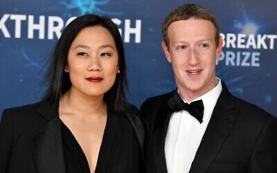 Priscilla Chan and Mark Zuckerberg, seen in 2019, are taking heat from conservatives for a $400 million donation to a nonpartisan center to assist local election offices ahead of the November 2020 vote. (Ian Tuttle/Getty Images for Breakthrough Prize)