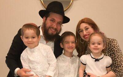 Rabbi Henoch Rosenfeld, his wife Sarah and three of their children (Photo provided by Henoch Rosenfeld)