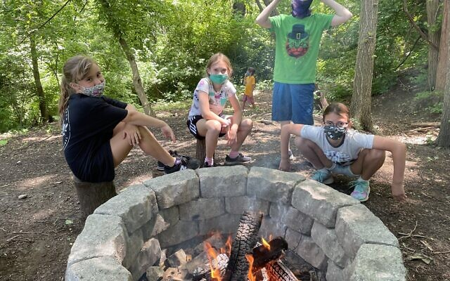 Fire and friendship combine at South Hills Day Camp. Photos courtesy of Emma Curtis via Jewish Community Center of Greater Pittsburgh.