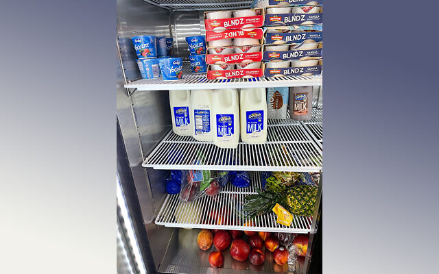 Rabbi Chezky Rosenfeld has opened a pop-up location on Murray Avenue with dairy items, fresh fruit and vegetables and prepackaged, ready-to-eat food items. Photo by Chezky Rosenfeld.