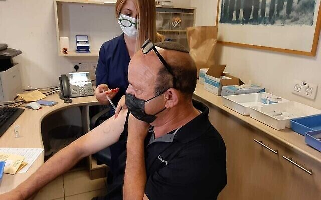 A man receives a booster dose of the coronavirus vaccine at Sheba Medical Center outside of Tel Aviv on July 12, 2021. (Photo courtesy Sheba Medical Center via The Times of Israel)