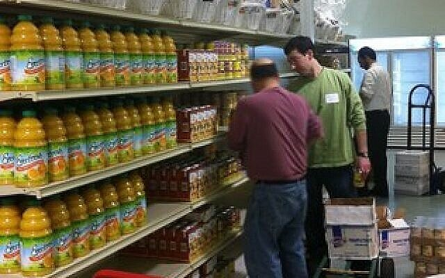 Volunteers stock shelves at the JFCS Squirrel Hill Food Pantry. (Photo courtesy of JFCS)