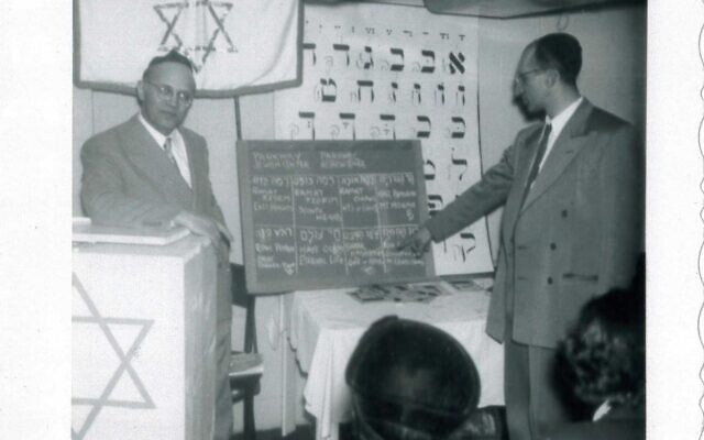 Rabbi Pinchas N. Gross (left) and Harry Katz (right) at a Dec. 25, 1954, meeting to select a new name for the former Eastmont Hebrew Congregation, now known as Parkway Jewish Center Shaar Ha-shamayim. (Image provided by Rauh Jewish Archives)
