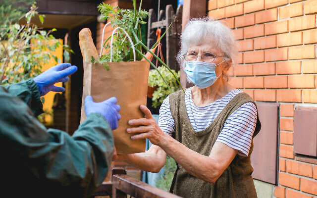 Food is delivered during the pandemic. Photo by aerogondo via iStock