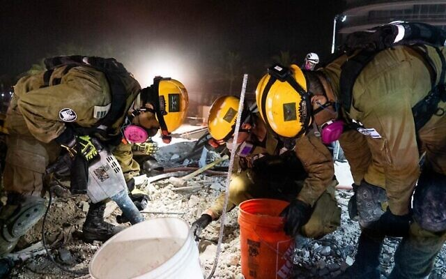 Soldiers with the IDF Home Front command helping find survivors amid in the rubble. Surfside, Florida. (Credit: IDF Home Front Command)