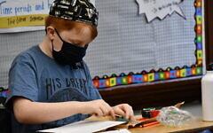 Painting peace rocks at Community Day School. Photo courtesy of Jennifer Bails via Community Day School