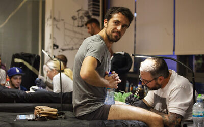 Healing Ink, a project of Artists 4 Israel, provides free tattoos to those injured in terrorist and antisemitic attacks. Photo by  Dillon Meyer