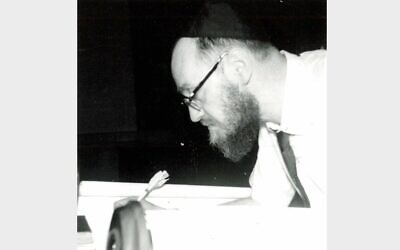 Rabbi Hershel Pfeffer completes a Torah scroll at Temple Ohave Israel in Brownsville, Pennsylvania, on May 24, 1964  (Photo courtesy of Rauh Jewish Archives)
