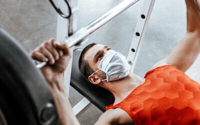 Mask wearing while working out. Photo by LightFieldStudios via iStock