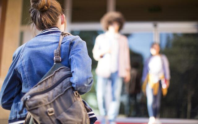 Student walks to school. Photo by seb_ra via iStock