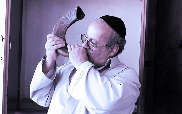 Afghanistan's last Jew, Zebulon Simentov, blows a ram's horn at the sole synagogue in Kabul. (Massoud Hossaini/AFP via Getty Images via JTA)