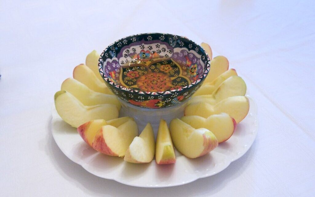 Jews around the world celebrate with Rosh Hashanah with apples and honey while off from work. Photo by Samuel, courtesy of Flickr.com.