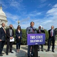 """Rep. Andy Levin speaks at a press conference introducing his """"Two-State Solution Act"""" on Capitol Hill, Sept. 23, 2021. He is flanked by, from left: Hadar Susskind, the president and CEO of Americans for Peace Now; Rep. Alan Lowenthal; Rep. Sara Jacobs; Rep. Peter Welch; and J Street President Jeremy Ben-Ami. (Photo by Ron Kampeas)"""