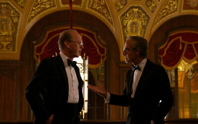 Michael Keaton as Kenneth Feinberg and Stanley Tucci as Charles Wolf. (Photo by Monika Lek / Netflix)