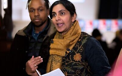 """Seattle City Councilmember Kshama Sawant speaks to reporters before her inauguration and """"Tax Amazon 2020 Kickoff"""" event in Seattle, Washington on Jan. 13, 2020. (Photo by Jason Redmond / AFP) (Photo by Jason Redmond/AFP via Getty Images via JTA)"""