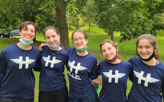 Miriam Levari, center, and Hillel Academy cross country teammates. Photo by Rabbi Sam Weinberg