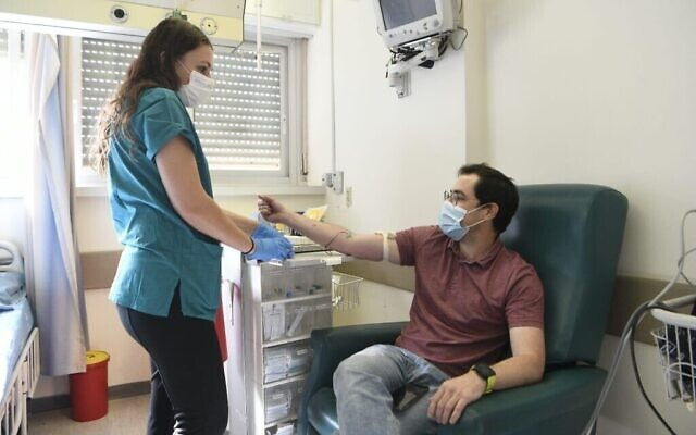 Anar Ottolenghi receives a dose of coronavirus vaccine developed by the Israel Institute for Biological Research at Jerusalem's Hadassah Ein Kerem Hospital, Nov. 1, 2020 (Courtesy photo via The Times of Israel)