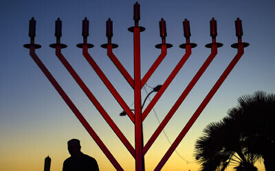 A Chabad menorah, distinguished by the diagonal—rather than curved—arms. (Photo by Mindy Schauer/Digital First Media/Orange County Register via Getty Images via JTA)