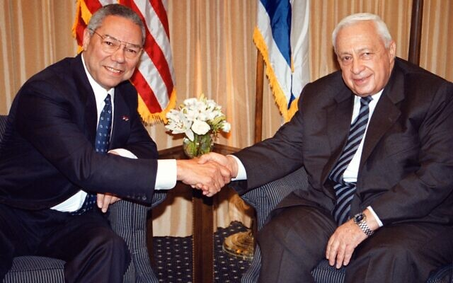 U.S. Secretary of State Colin Powell, left, shakes hands with Israeli Prime Minister-elect Ariel Sharon in Jerusalem on Feb. 25, 2001. (Getty Images/Pool photo via JTA)