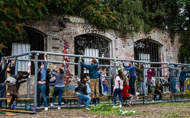 Participants at the Festival of Resilience in Berlin build a sukkah. (Photo by Debi Simon for Hillel Deutschland)