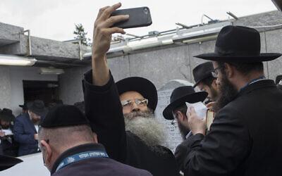 Lubavitch rabbis from around the world visit the grave of Rebbe Menachem Schneerson on Nov. 2, 2018, in Queens, New York.  (Photo by Andrew Lichtenstein/Corbis via Getty Images via JTA)