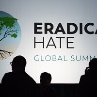Attendees of the Eradicate Hate Global Summit 2021 chat at the end of the day's sessions on Oct. 18, 2021, at the David L. Lawrence Convention Center in downtown Pittsburgh. (Photo by Lindsay Dill)