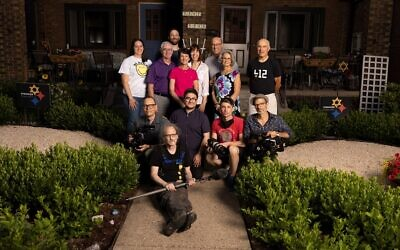 """The Mallinger and Wedner families with the """"Not In Our Town"""" film crew. Photo provided by Patrice O'Neill"""