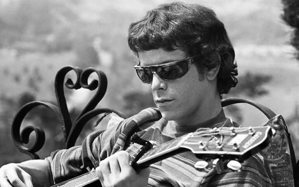 """Lou Reed proclaimed that """"My God is rock 'n' roll,"""" hoping to become a famous musician at a young age. (Photo courtesy of AppleTV+)"""