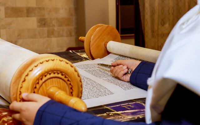 Reading Torah. Photo by photovs via iStock