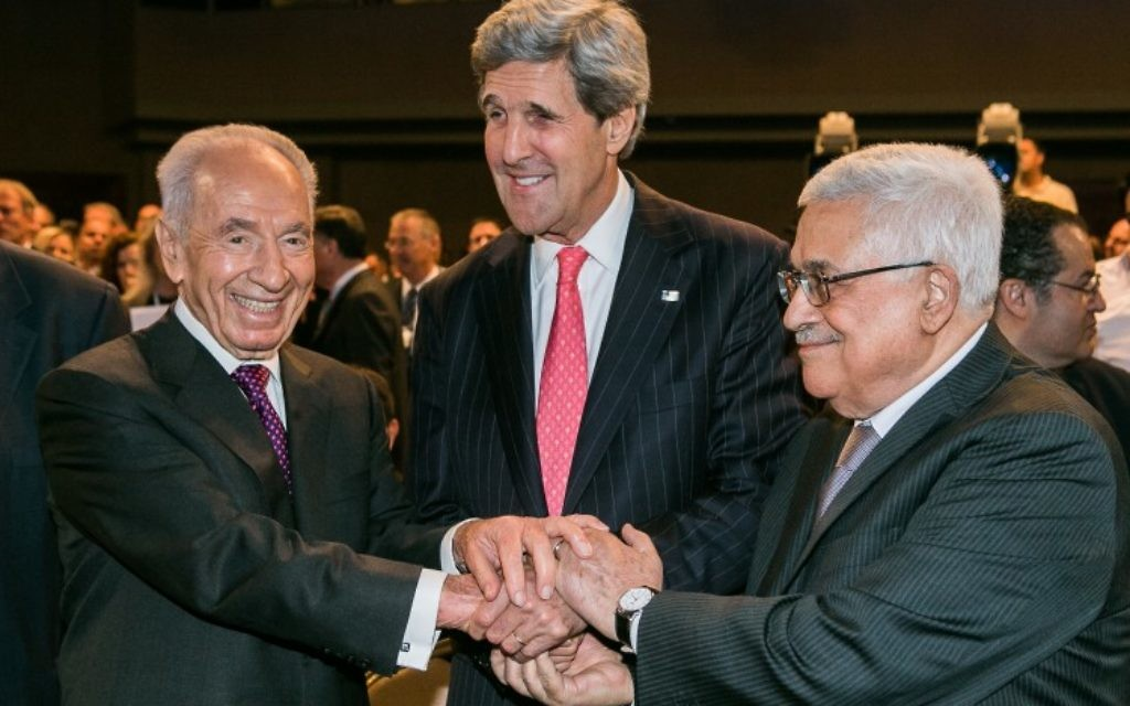 Former Israeli President Shimon Peres with John Kerry and Mahmoud Abbas at the World Economic Forum in Jordan, May 2013.