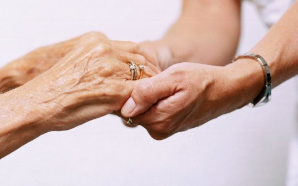 Elderly and young people lock hands