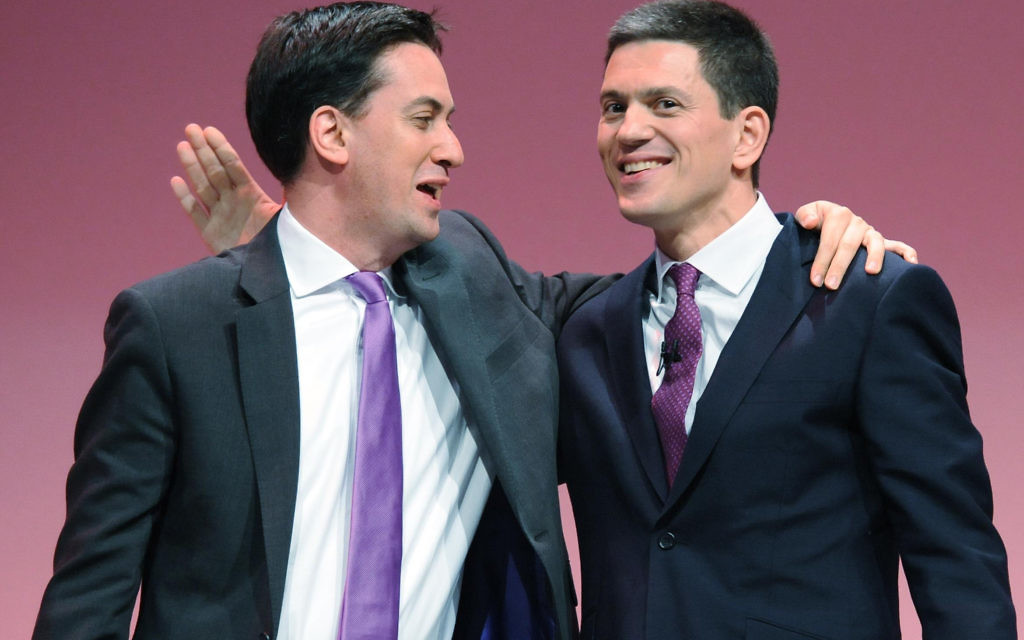 Ed Miliband (left) with his brother David, putting a brave face on strained relations in 2013