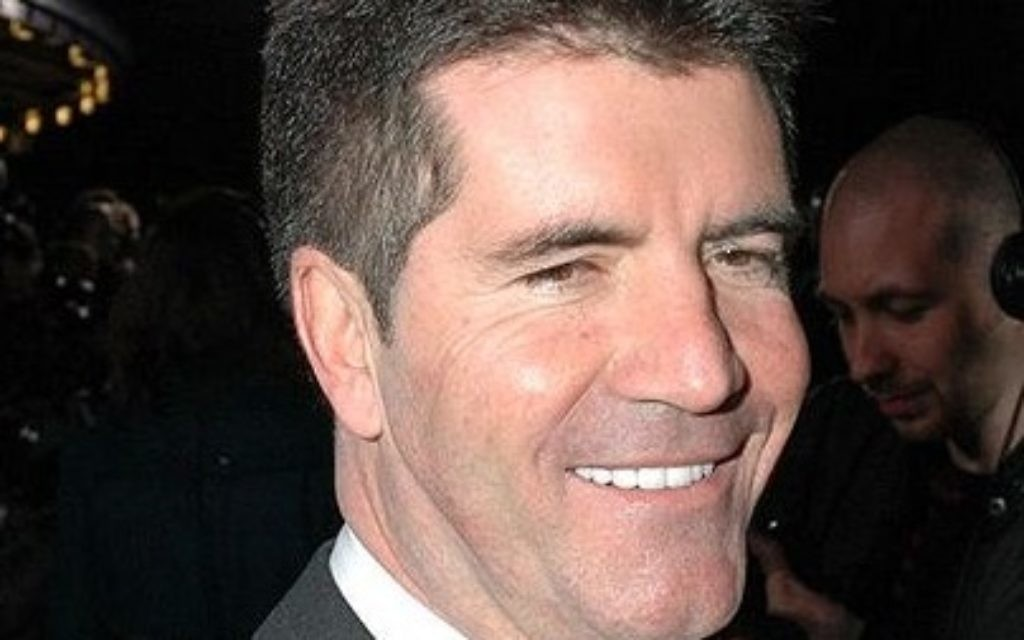 Simon Cowell is set to become a dad for the first time early next year.