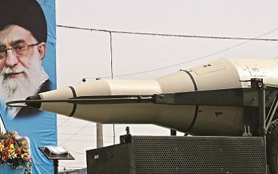 A missile is displayed by Iran's Revolutionary Guard, in front of a portrait of the Iranian supreme leader Ayatollah Ali Khamenei. (2013)
