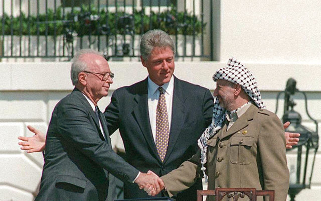 No great shakes: Rabin, Clinton and Arafat on the White House lawn in September 1993.