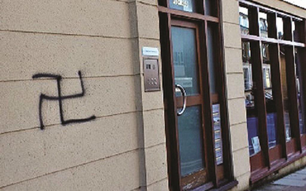 Swastika graffiti on a wall on Finchley