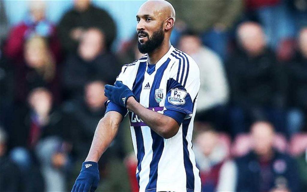 Anelka making his shocking goal celebration gesture.