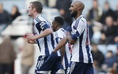 West Bromwich Albion's Nicolas Anelka, right, gestures as he celebrates his goal against West Ham United during their English Premier League soccer match at Upton Park.