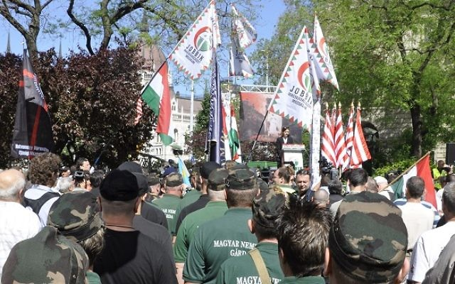 Members of the New Hungarian Guard stand at a Jobbik rally against a gathering of the World Jewish Congress in Budapest, 4 May 2013  Source: Wikimedia Commons. Credit: Michael Thaidigsmann