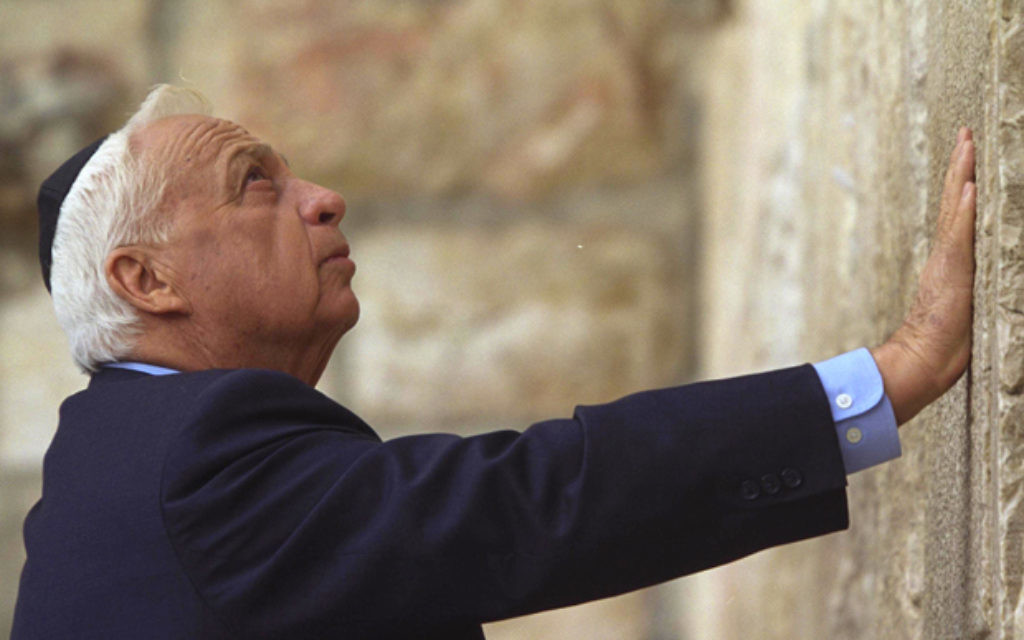 Ariel Sharon, pictured at the Western Wall, has been in a coma for eight years.