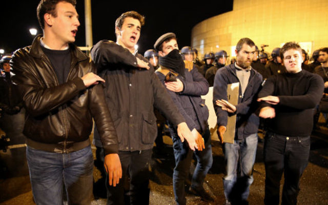 Dieudonne's fans outside one of his cancelled performances  in Nantes, western France, performing the quenelle
