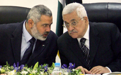 Palestinian Authority President Mahmoud Abbas, right, and Ismail Haniyeh, formerly of Hamas, left.