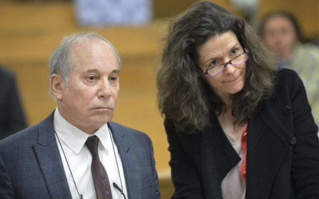 Singer Paul Simon, left, and his wife Edie Brickell.