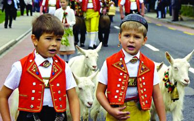 Appenzeller boys in traditional dress take part in a pageant in Herisau, Switzerland