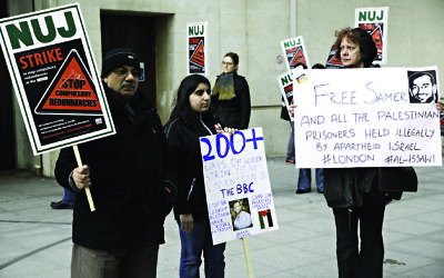 Protesters gathered outside the BBC in 2013 holding placards in protest against the keeping of Palestinian prisoners in Israeli jails